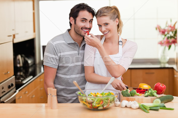 Young couple slicing pepper in their kitchen Stock photo © wavebreak_media