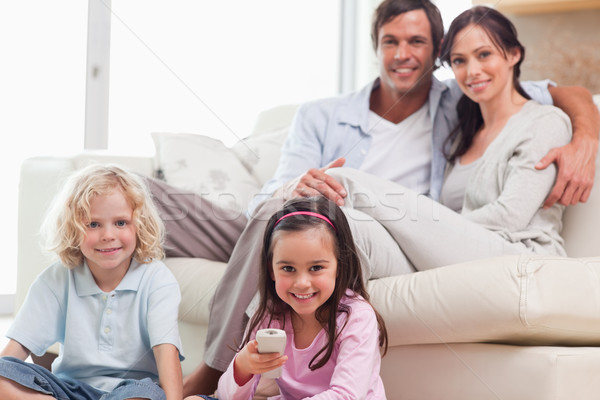 Lovely family watching television in a living room Stock photo © wavebreak_media