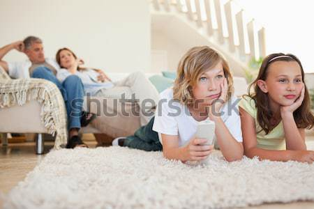 Siblings lying on the carpet watching tv together Stock photo © wavebreak_media