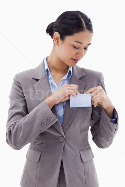 Portrait of a businesswoman clipping her badge against a white background Stock photo © wavebreak_media