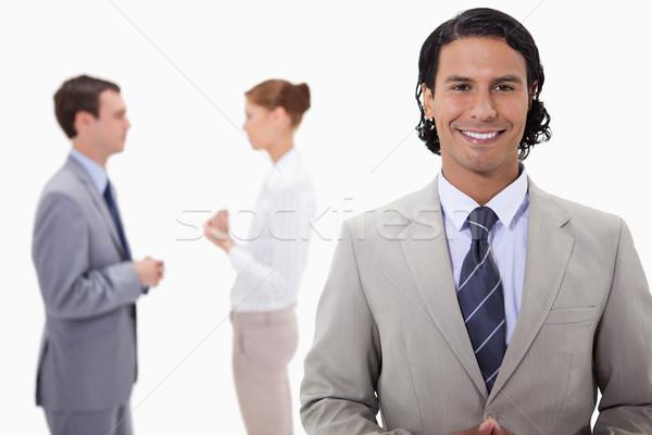 Zakenman praten collega's achter witte team Stockfoto © wavebreak_media
