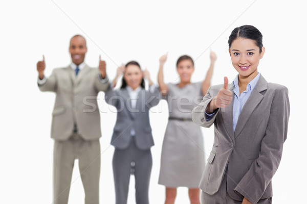 Businesswoman approving with approving co-workers in the background Stock photo © wavebreak_media