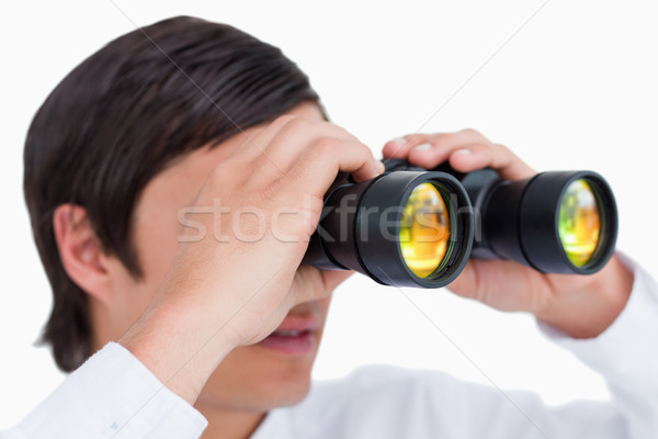 Close up side view of tradesman with spy glass against a white background Stock photo © wavebreak_media