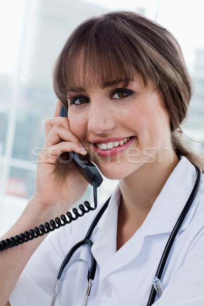 Portrait of a happy doctor on the phone in her office Stock photo © wavebreak_media