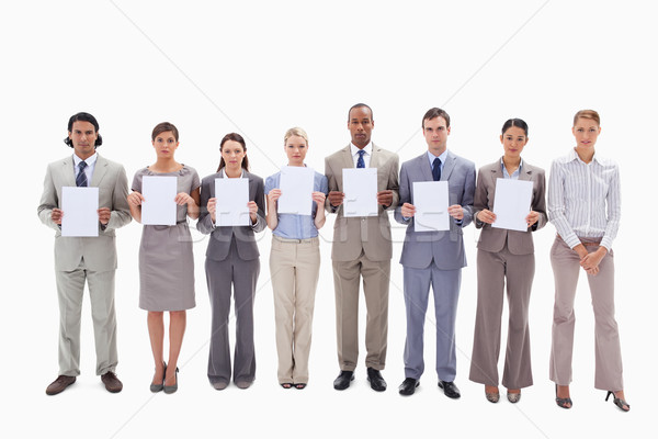 Business people holding seven white supports for letters against white background Stock photo © wavebreak_media