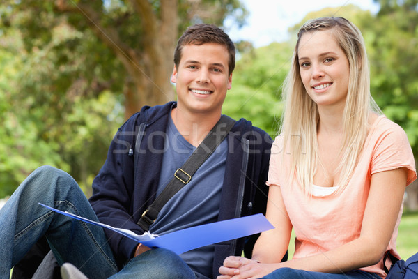 Portrait of a tutor helping a teenager to revise in a park Stock photo © wavebreak_media