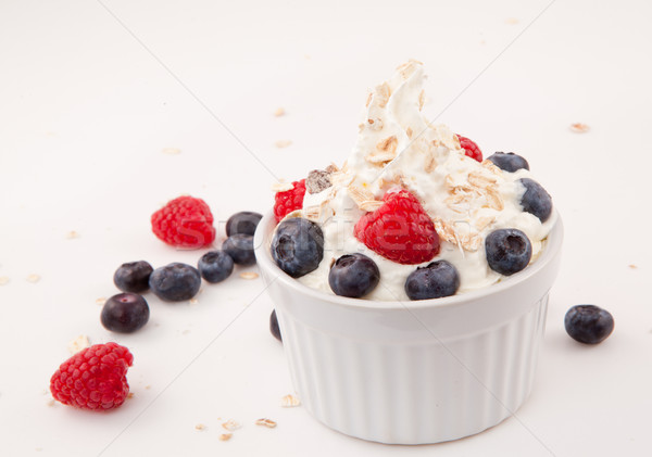White jar of berries and whipped cream Stock photo © wavebreak_media