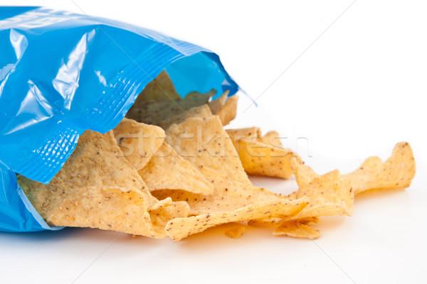 Open bag with fallen tacos against white background Stock photo © wavebreak_media