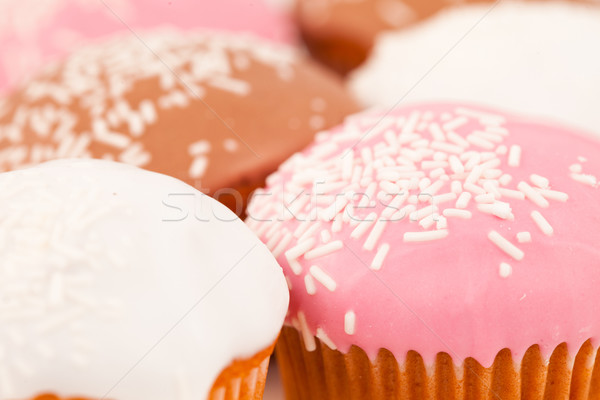 Many muffins with icing sugar against a white background Stock photo © wavebreak_media