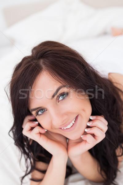 Gioioso donna letto mattina luminoso camera da letto Foto d'archivio © wavebreak_media