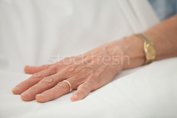 Hand of an old woman with golden jewelry in hospital bed Stock photo © wavebreak_media