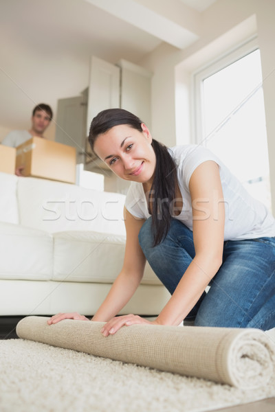 Two young people moving into the house and furnishing the living room Stock photo © wavebreak_media