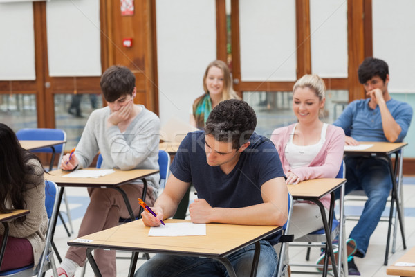 Öğrenciler oturma sınav oda yazı çalışmak Stok fotoğraf © wavebreak_media
