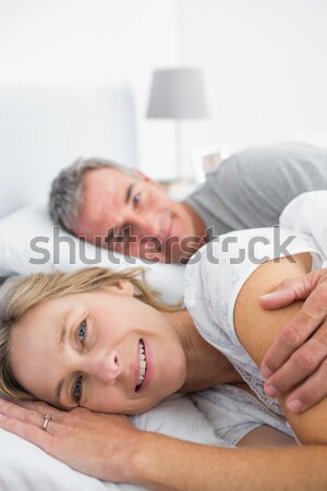 Woman relaxing at home with her feet up on the sofa Stock photo © wavebreak_media