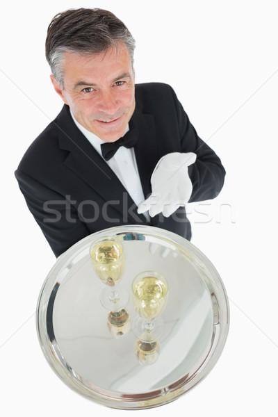 Stock fotó: Mosolyog · pincér · felajánlás · tálca · szemüveg · pezsgő