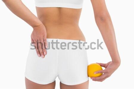 Vrouw shorts oranje achteraanzicht vers witte Stockfoto © wavebreak_media