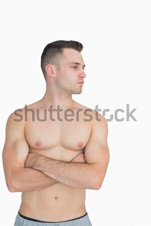 Bare chested man with arms crossed looking to his side Stock photo © wavebreak_media