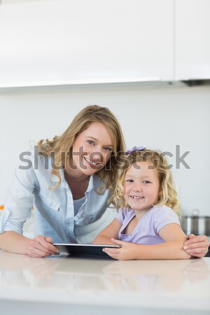 Happy mother and daughter with laptop Stock photo © wavebreak_media