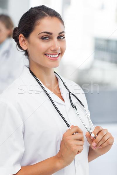Mulher atraente médico estetoscópio hospital feliz Foto stock © wavebreak_media
