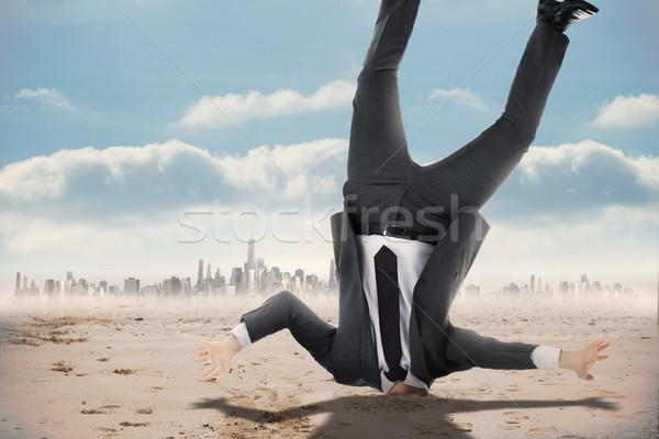 Composite image of businessman burying his head Stock photo © wavebreak_media