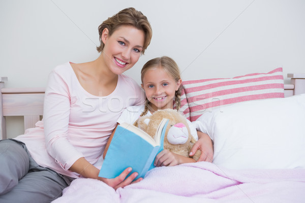 Mother with her daughter at bedtime Stock photo © wavebreak_media