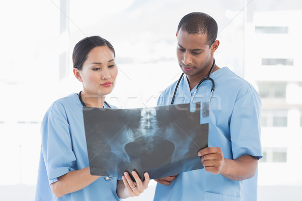 Two surgeons examining xray Stock photo © wavebreak_media