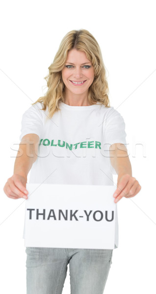 Smiling young female volunteer holding thank you paper Stock photo © wavebreak_media