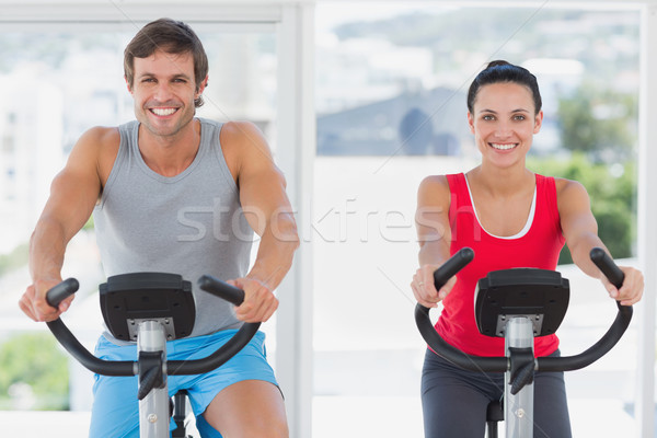 Smiling young couple working out at spinning class Stock photo © wavebreak_media