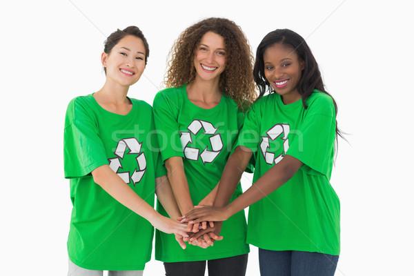 Team milieu glimlachend camera handen samen Stockfoto © wavebreak_media