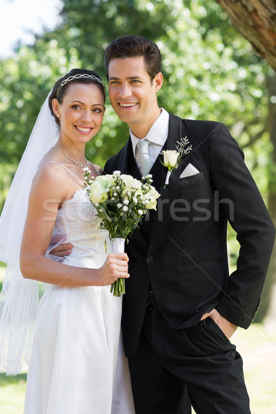 Newly wed couple looking away in park Stock photo © wavebreak_media