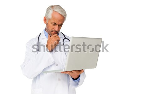 Concentrated male doctor using laptop Stock photo © wavebreak_media