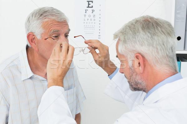 Man wearing glasses after taking vision test at doctor Stock photo © wavebreak_media