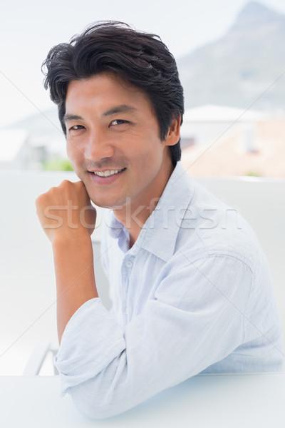 Feliz homem sorridente câmera fora varanda Foto stock © wavebreak_media