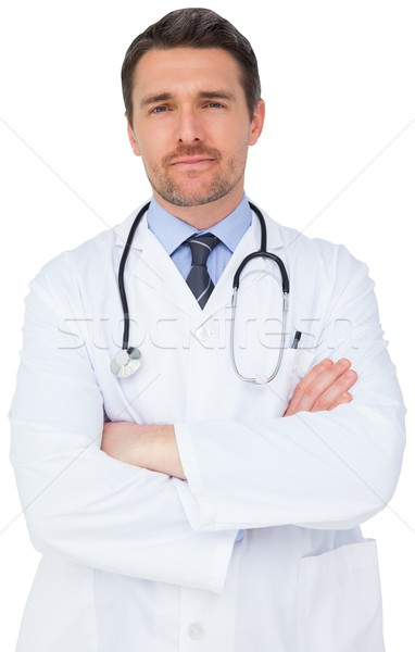 Handsome young doctor with arms crossed Stock photo © wavebreak_media