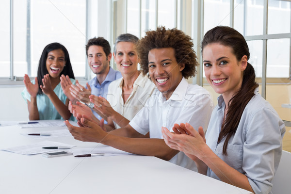 Business people clapping and smiling at camera Stock photo © wavebreak_media