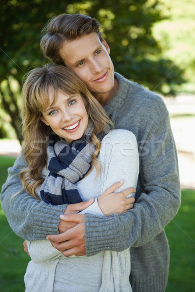 Cute couple hugging with girl smiling at camera in the park Stock photo © wavebreak_media