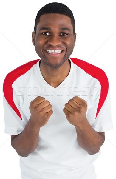 Excited football fan in white cheering Stock photo © wavebreak_media