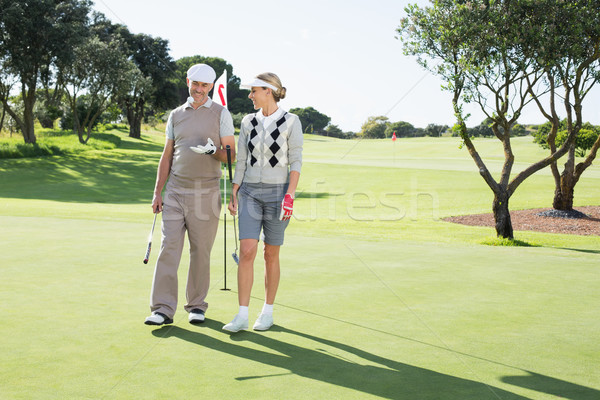 Golfing couple smiling at each other on the putting green Stock photo © wavebreak_media