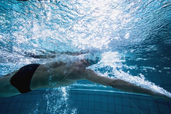 Fit swimmer training by himself Stock photo © wavebreak_media