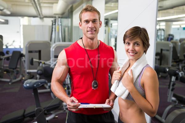 Yakışıklı personal trainer müşteri gülen kamera spor salonu Stok fotoğraf © wavebreak_media