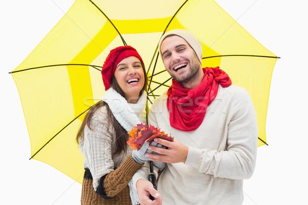 Atrakcyjny ciepły ubrania parasol Zdjęcia stock © wavebreak_media