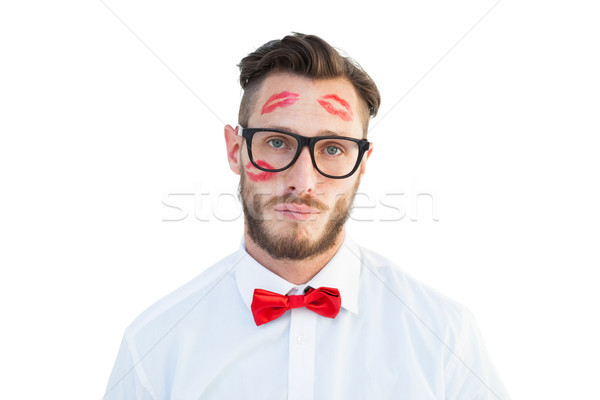 Geeky hipster with kisses on his face Stock photo © wavebreak_media