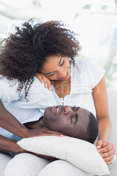 Attractive couple cuddling on the couch Stock photo © wavebreak_media