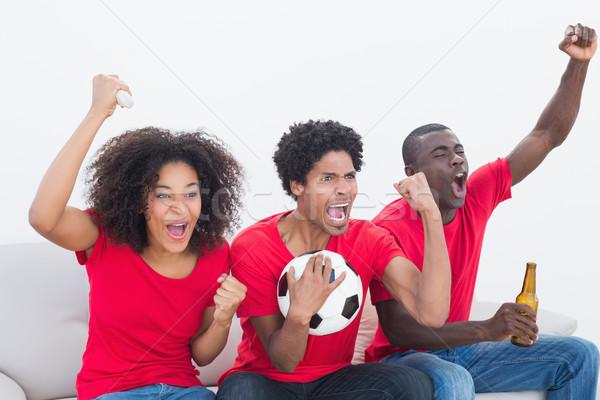 Futbol fanlar kırmızı oturma kanepe Stok fotoğraf © wavebreak_media