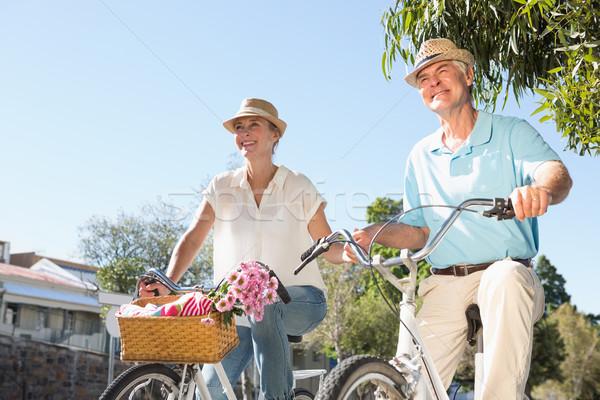 Happy senior couple going for a bike ride in the city Stock photo © wavebreak_media