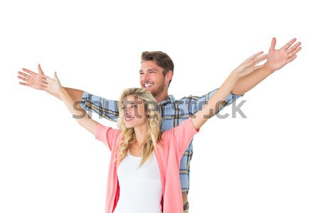 Attractive young couple standing with hands out Stock photo © wavebreak_media