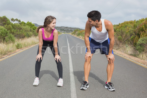Couple running on the open road together Stock photo © wavebreak_media