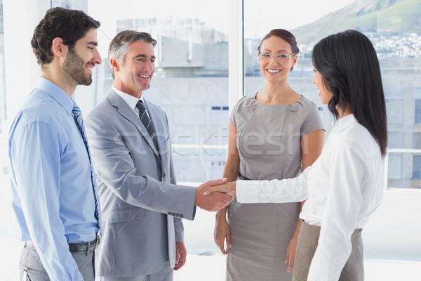 Two fellow employees shaking hands Stock photo © wavebreak_media