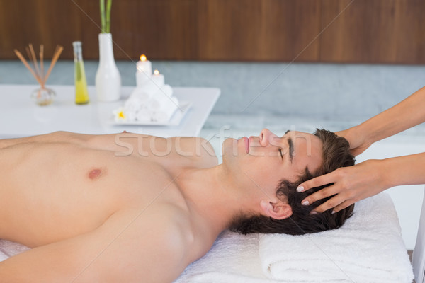 Young man receiving head massage at spa center Stock photo © wavebreak_media