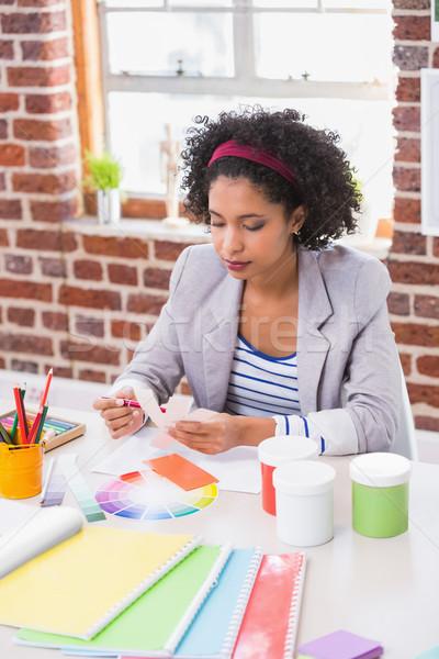 Stock photo: Interior designer looking at colours